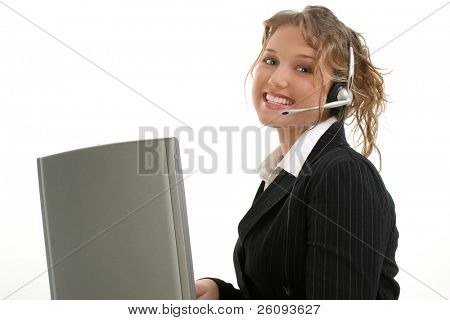 Beautiful 16 year old teen in suit at laptop wearing headset. Shot in studio over white.