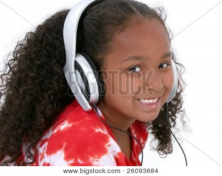 Adorable Six Year Old Girl Wearing Headphones.  Shot in studio over white.