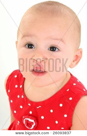 Close-up of a beeautiful Baby Girl with stork bite (telangiectatic naevus) on Upper Lip. Shot in studio over white.