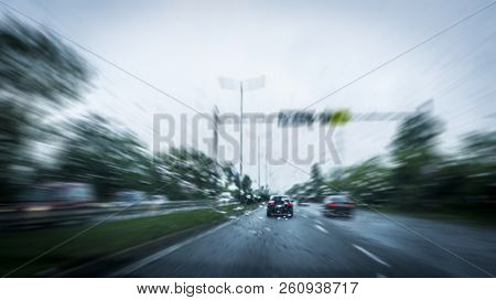 Fast-moving Cars On The Highway And Blurry Effect. Blurry Effect Of High Speed Car. Driving At An Un