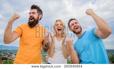 Woman And Men Look Emotional Successful Celebrate Victory Sky Background. We Are Winners. Celebrate