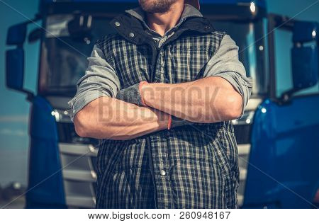 Truck Driver Workhorse. Caucasian Men In Front Of His Vehicle With Crossing Arms. Powerful Transport