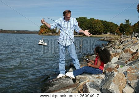 Interacial father daughter fishing.  Caught a shoe.