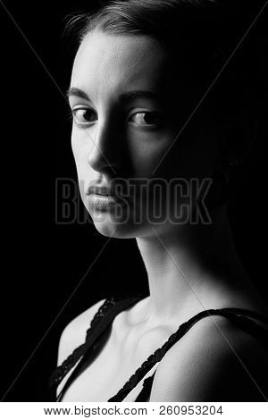 Beautiful Sad Pensive Sensual Young Woman On Black Background Looking At Camera, Monochrome