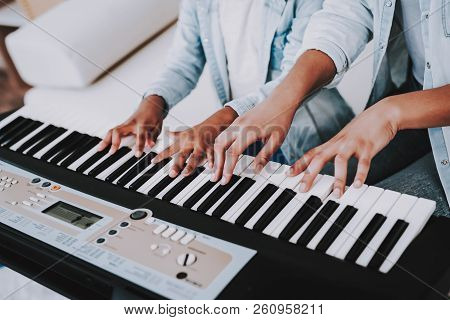 Positive Day With Mother And Daughter. Offspring With Mother Play On Piano. People Play On Piano. Em