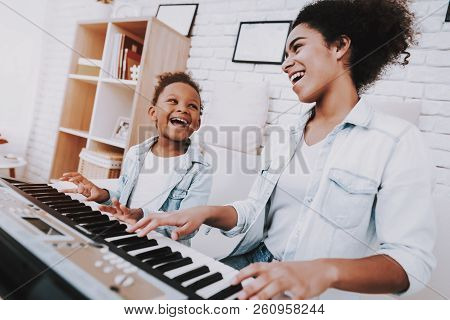 Positive People Play On Piano. Relax For Mother And Little Girl. Hobbies For Mother. Positive Time F