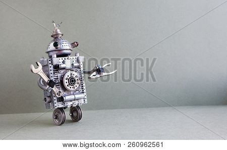 Silver Metallic Robot Handyman On Gray Background. Two Wheels Domestic Servant Robotic Character Wit