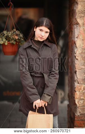Teenager Girl With Long Brown Hair Street Photo With Shopping Bag