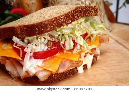 Fresh turkey sandwich with honey rosted deli turkey, shredded lettuce, cheddar cheese, tomatoes and ranch dressing on whole wheat.