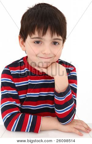 Adorable five year old boy making bored grin expression.  Face resting on hand.
