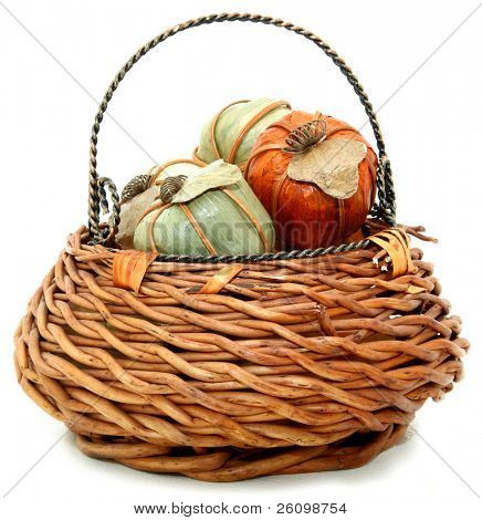 Basket with fall colored paper mache pumpkins.
