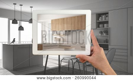 Hand Holding Tablet Showing Real Finished Minimalist White And Wooden Kitchen. Modern Kitchen Cad Sk