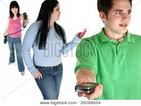 Focus on young man.  Attractive young man handing cellphone forward.