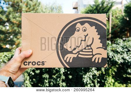 Paris, France - Jan 23, 2018: Man Holding A Cardboard Box With New Pair Of New Shoes By Crocs