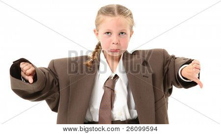 Adorable 6 year old blonde girl in over-sized baggy suit with thumbs down and frown over white background.