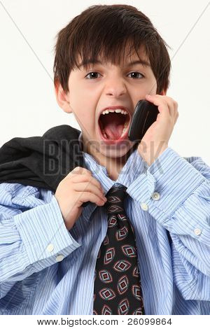 Adorable seven year old french american boy in over sized suit over white background yelling in cellphone.