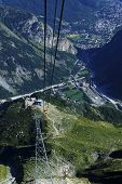 View from the Mont Blanc Skyway Monte Bianco cable car towards Courmayeur and Aosta Valley. Italy. poster