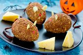 Mice cakes - funny and spooky Halloween dessert idea for kids, edible mouse cookies with red eyes and almonds ears, cute rat cakes poster