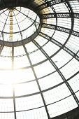 The dome of the wonderful gallery Vittorio Emanuele between the duomo and P.za della Scala in Milan (Italy). poster