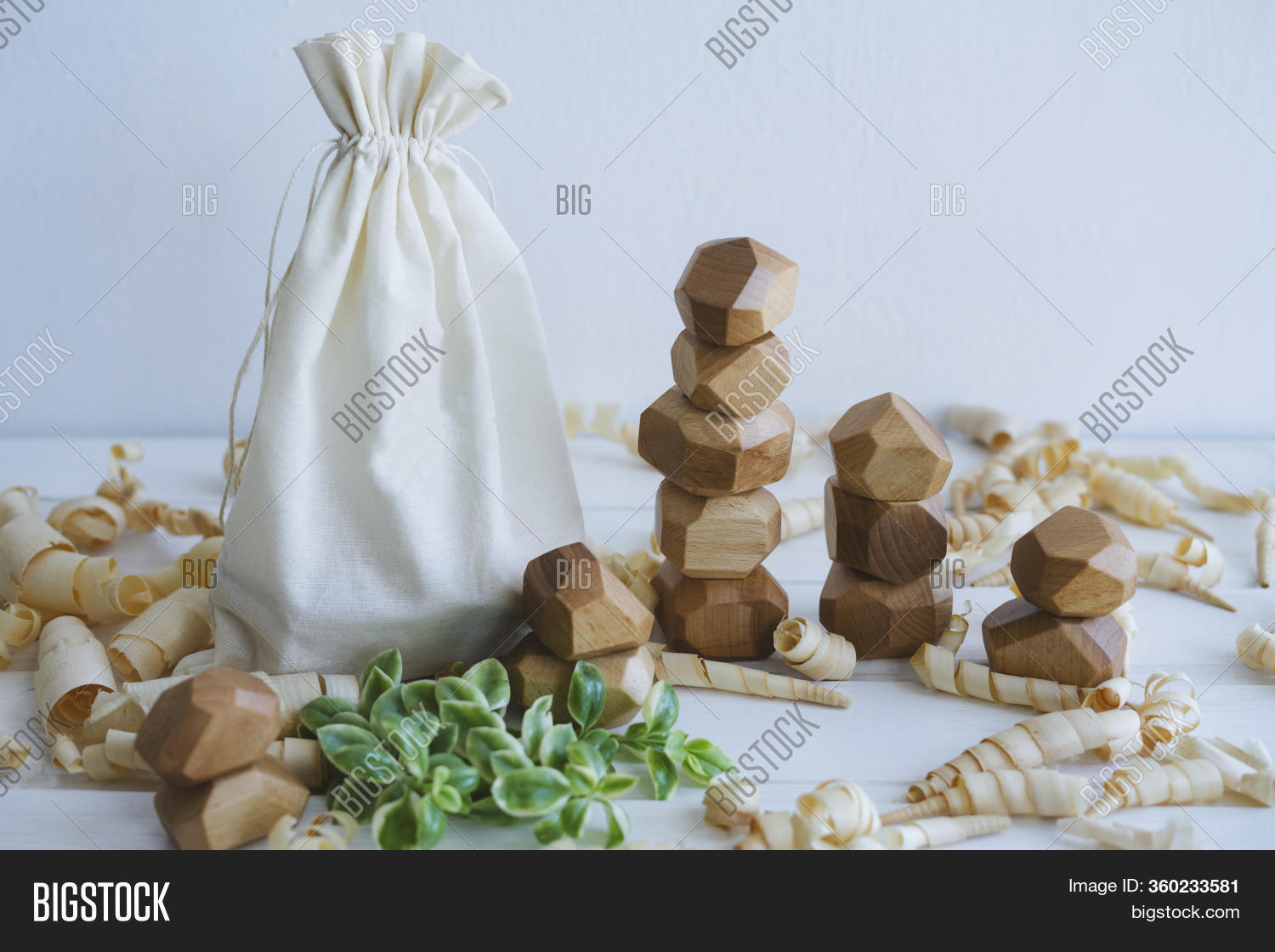 Linen Bag For Packing Wooden Toys. Wooden Stones. A Toy Made Of Natural Wood. Unusual Cubes For Deve