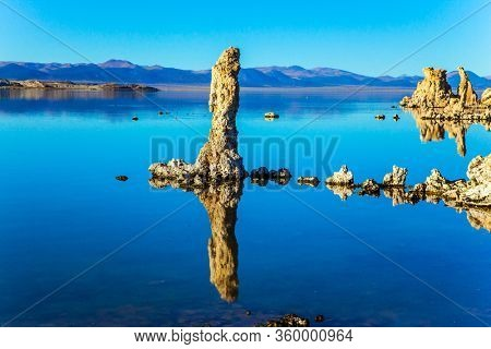 California, USA. Mono Lake. Picturesque lake with lime-tuff towers of fancy shape. Evening by the lake. Dusk. The concept of ecological, exotic and photo tourism