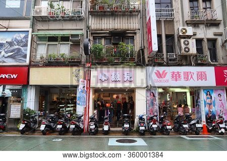 Keelung, Taiwan - November 23, 2018: Parked Motor Scooters And Fashion Shops In Keelung, Taiwan. Kee