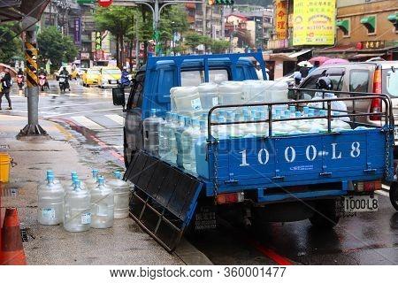 Keelung, Taiwan - November 23, 2018: Office Water Cooler Bottles Delivery In Keelung, Taiwan. Keelun