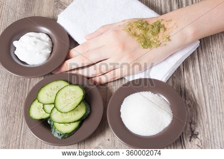 Skin Care At Home. A Woman Applies A Natural Homemade Scrub To Her Hand. Ingredients For Making The