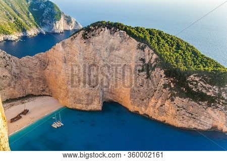 The magical island of Zakynthos on the Mediterranean. Greece. The famous rusty ship, Navajo Bay (Navagio Beach). The cove with a small sandy beach. The concept of a summer beach and photo tourism