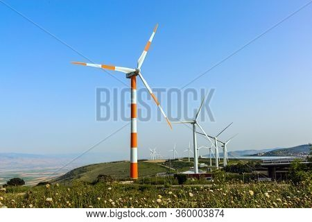 Wind generator - wind farm on Mount Gilboa. Israel. Modern equipment for generating electric energy. The concept of environmental friendliness, environmental protection and tourism photo