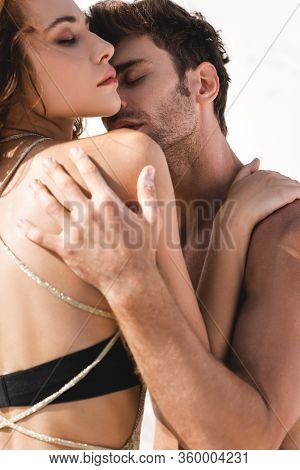 Passionate Sexy Young Couple Embracing With Closed Eyes On Beach