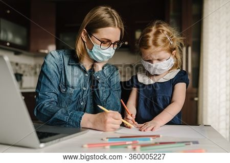 Coronavirus. Mom And Daughter Wearing Protective Mask In Quarantine. Stay At Home, Woman Working On