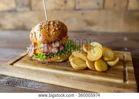 Home Made Cheeseburger, Served With Home Made Potato Chips