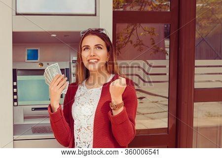 Withdraw.  Atm. Portrait Happy Smiling Woman Exults Pumping Fists Ecstatic Celebrates Success Holdin