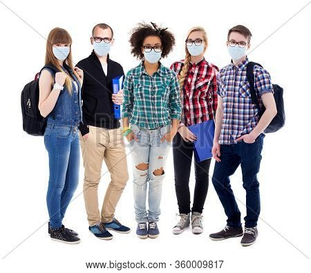 Corona Virus, Pandemic, Health Care And Education Concept - Group Of Teenagers Or Students In Protec