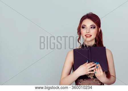 Daydream. Beautiful Smiling Woman Retro Hair Style Girl With A Book Looking Up To Side Isolated Ligh