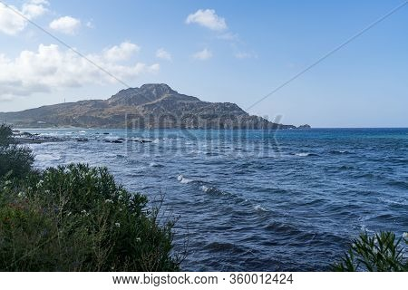 Seascape With Mountains In Crete With Blue Sky