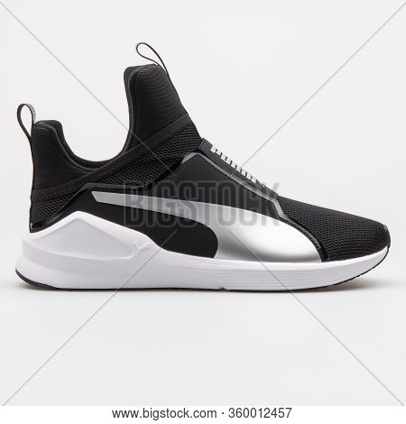 Vienna, Austria - August 14, 2017: Puma Fierce Core Black And Silver Sneaker On White Background.