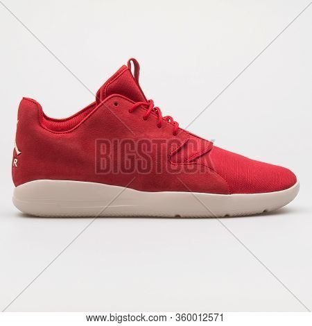 Vienna, Austria - August 14, 2017: Nike Air Jordan Eclipse Lea Red Sneaker On White Background.