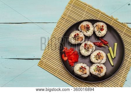 Korean Roll Gimbap(kimbob). Steamed White Rice (bap) And Various Other Ingredients. Trendy Turquoise