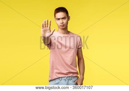 Judgemental And Skeptical Young Asian Guy Pull One Hand In Prohibition, Tell No, Stop It, Serious Lo