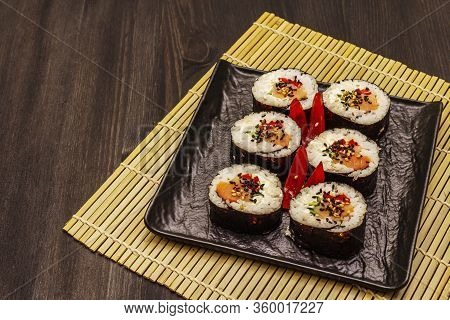 Korean Roll Gimbap(kimbob). Steamed White Rice (bap) And Various Other Ingredients. Trendy Black Bac