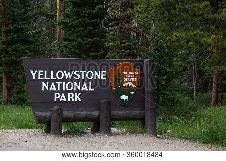 Yellowstone National Park,  Montana, Usa - July 13, 2014:  A Wooden Sign For Yellowstone National Pa