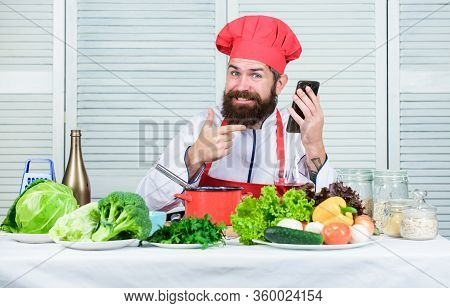 Elearning Concept. Man Chef Searching Internet Recipe Cooking Food. Chef Smartphone Watch Culinary S