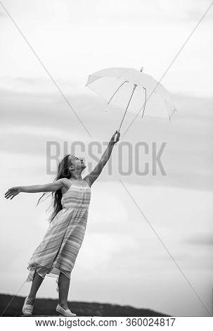 Touch Sky. Girl With Light Umbrella. Fairy Tale Character. Happy Childhood. Feeling Light. Anti Grav