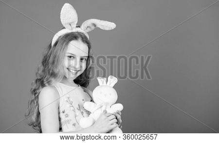 I Love Easter. Little Child In Easter Rabbit Style Playing With Toy. Small Kid With Cute Toy. Easter