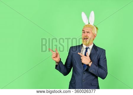 Preparation For Holy Sunday. Happy Manager Pointing Fingers At Something. Bearded Man With Bunny Ear