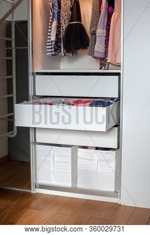 Vertical Storage Of Clothing. Childrens Room. Clothing Folded For Vertical Storage In The Linen Draw