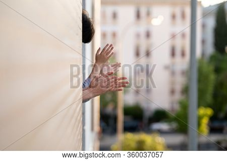 People Clapping In The Window In Support Of People Who Fight Against The Coronavirus