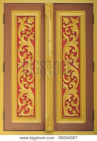Ancient Golden carving wooden window of Thai temple in Thailand.